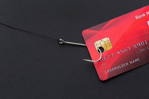 Top view of credit card and hook for phishing
