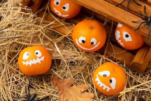 Top view creepy halloween concept with pumpkins
