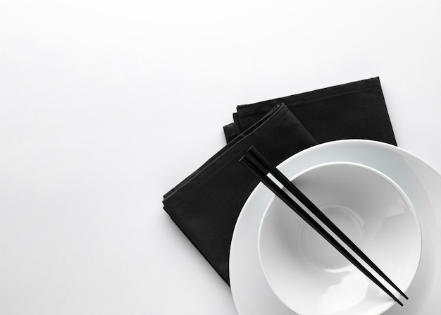 Top view of crockery with chopsticks and copy space