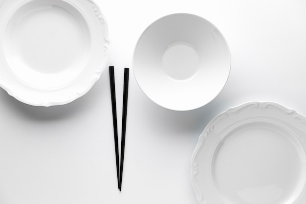 Top view of crockery with chopsticks
