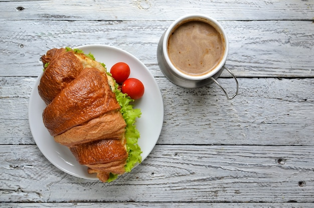 Top view croissant sandwich with coffee