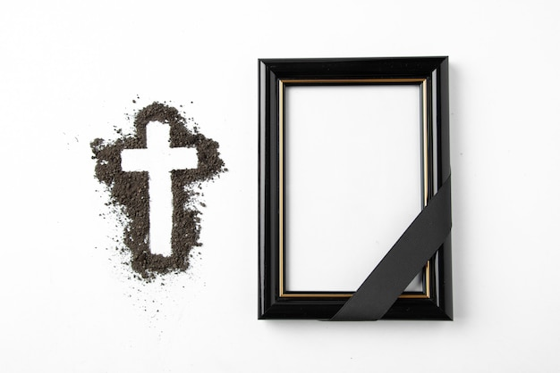 Top view of cross shape with picture frame on white