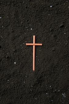 Top view of cross on soil grim reaper funeral death