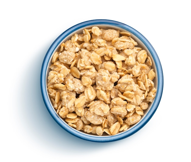 Top view of crunchy muesli bowl on white background