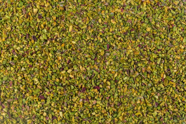 Top view crushed or granulated pistachios texture