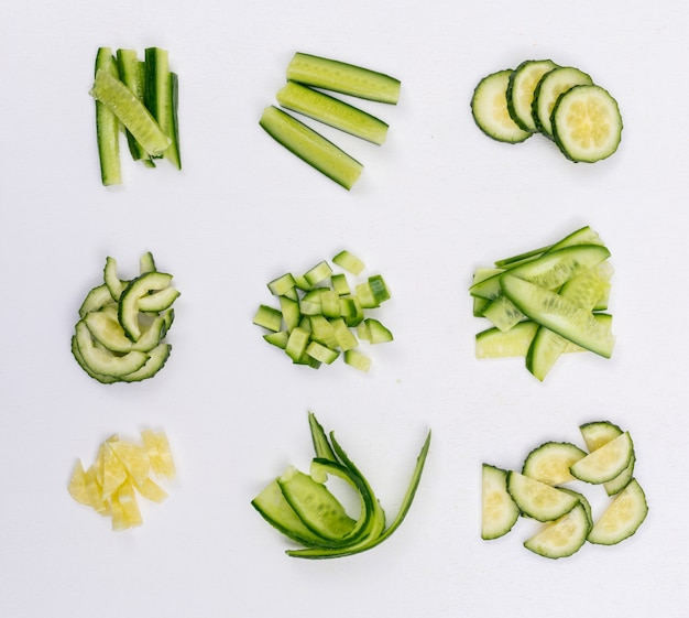 Top view cucumber sliced and chopped on white  horizontal