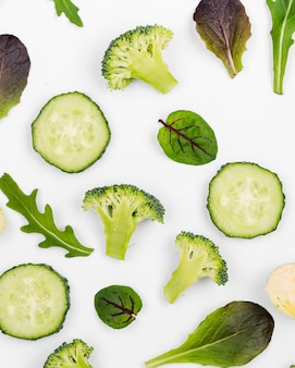 Top view cucumber slices with salad leaves