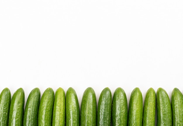 Top view cucumber with copy space on white  horizontal 1