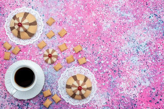 Top view cup of coffee along with chocolate cookies on the colored background cookie biscuit sweet color