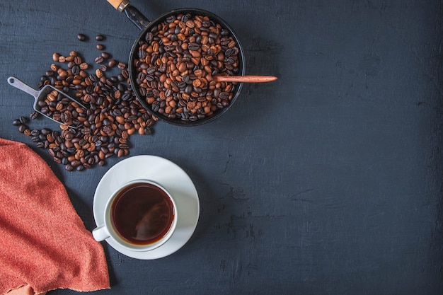 Top view cup of coffee and coffee beans