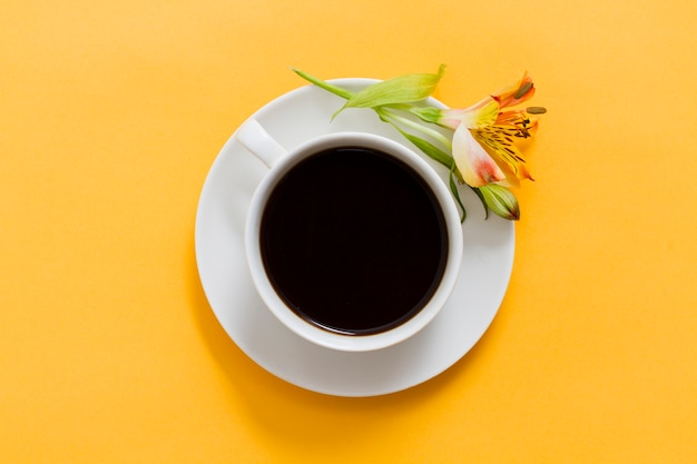 Top view cup of coffee and flower