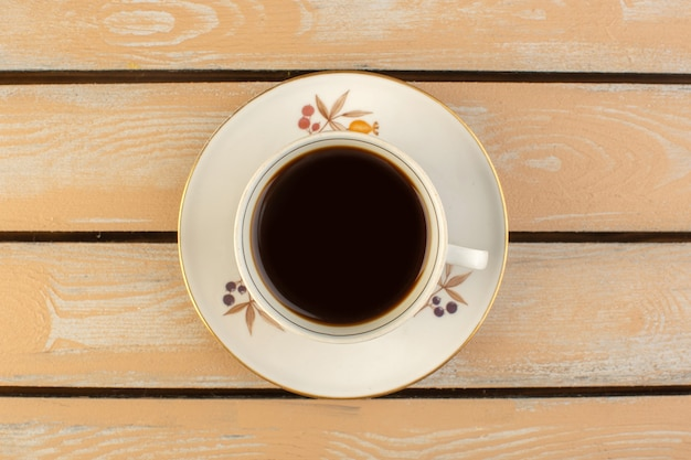 A top view cup of coffee hot and strong on the cream colored rustic table drink coffee photo strong