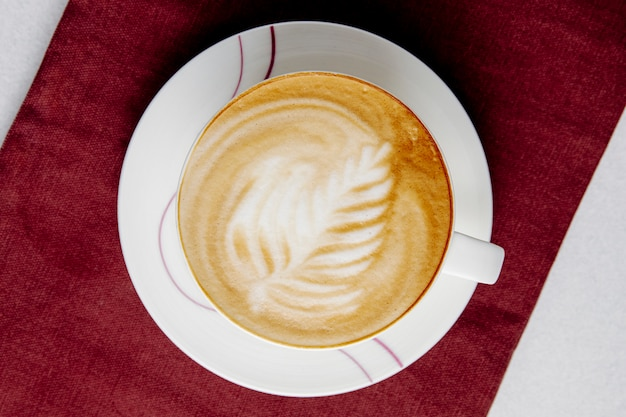 Top view of a cup of coffee latte on table