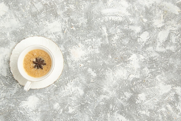 Top view cup of coffee on light-white surface