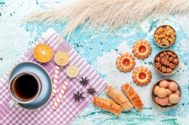 Top view cup of coffee with bagels and cookies on light-blue background cake bake sweet sugar pie biscuit