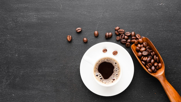 Top view cup of coffee with beans