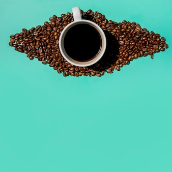 Top view cup of coffee with grains