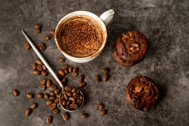 Top view cup of coffee with muffins