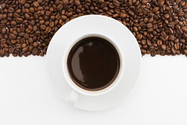 Top view cup of coffee with roasted beans