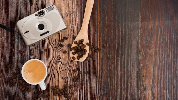 Top view cup of coffee on wooden table