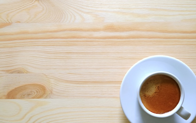 Top view of a cup of espresso on the wooden table