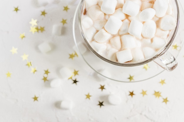 Top view of cup of hot delicious cocoa drink with marshmallows.