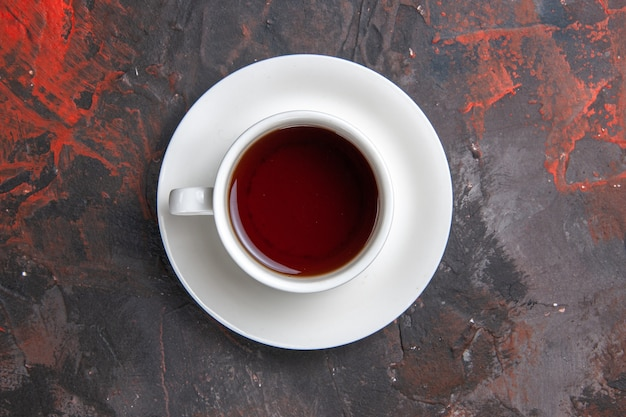 Top view cup of tea on a dark table color dark tea ceremony