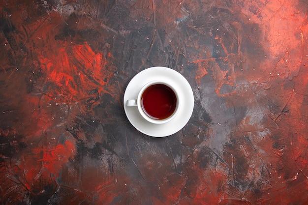 Top view cup of tea on dark table color dark tea ceremony