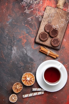 Top view cup of tea with choco cookies on dark table tea  biscuits