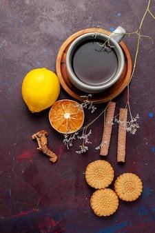Top view cup of tea with cinnamon and cookies on dark surface cookie biscuit sugar pie sweet