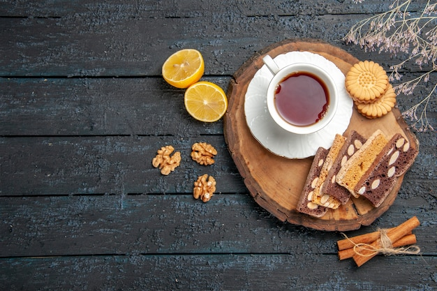 Top view cup of tea with cookies and cakes