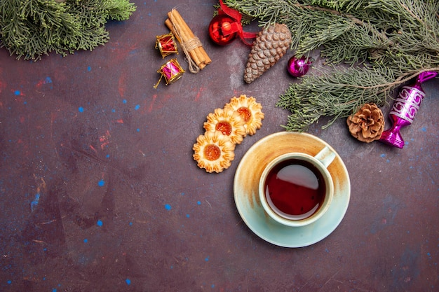 Top view cup of tea with cookies on dark desk tea cookie biscuit cake