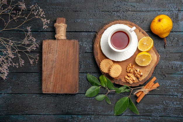 Top view cup of tea with cookies and fruits, sweet biscuit sugar