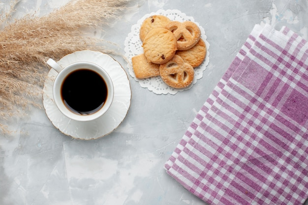 Top view of cup of tea with delicious little cookies on light, cookie biscuit sweet tea sugar
