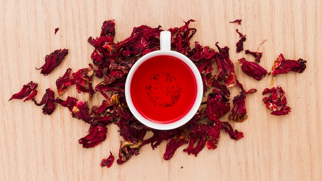 Top view cup of tea with dry leaves