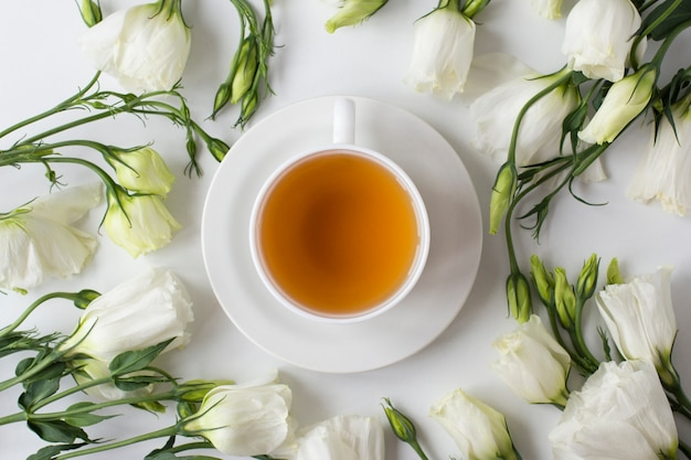 Top view of cup of tea with flowers
