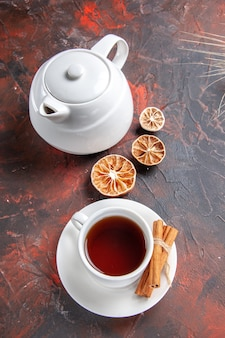 Top view cup of tea with kettle on dark table color ceremony tea dark
