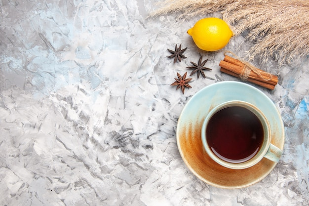 Top view cup of tea with lemon on light table fruit tea color