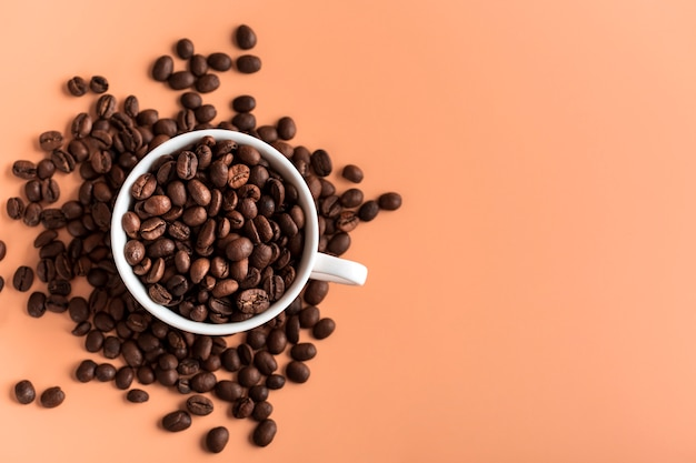 Top view cup with organic coffee beans