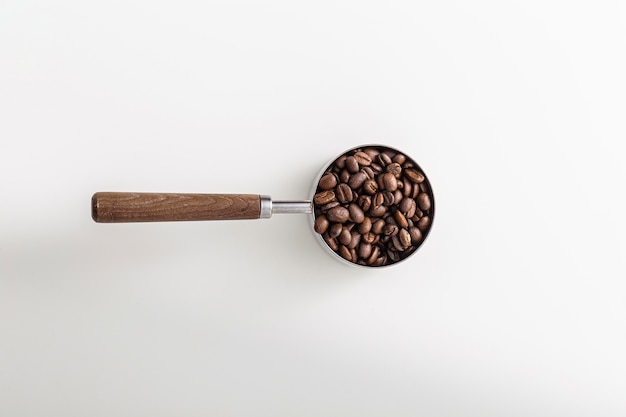 Top view of cup with roasted coffee beans