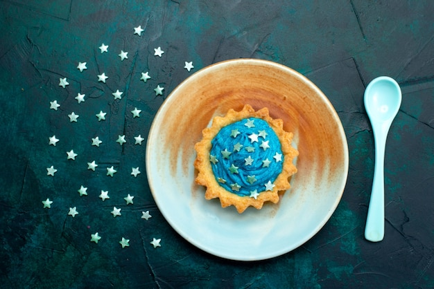 Top view of cupcake with interesting shadow effect and stars decoration