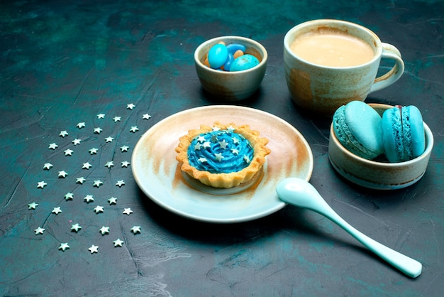 Top view of cupcake with stars next to dessert spoon and delicious coffee