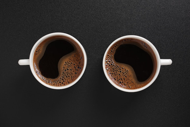 Top view cups with coffee on table