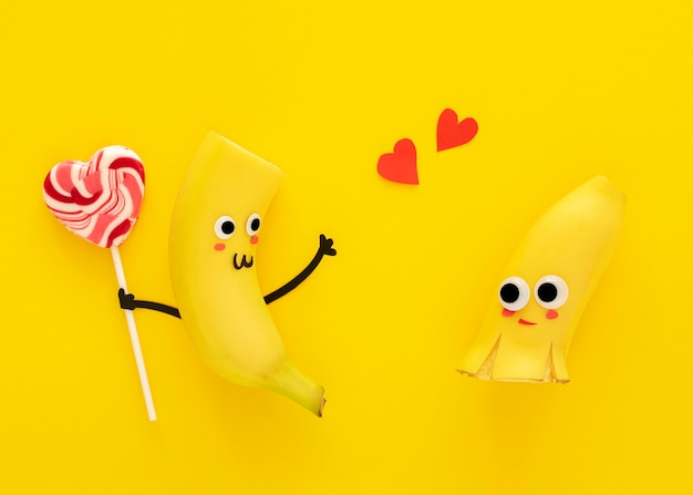 Top view cute bananas with lollipop