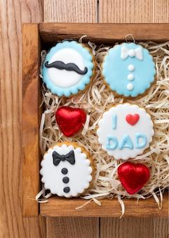 Top view cute cookies in wooden box