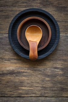 Top view cute little wooden spice spoon and two cup holders on wooden table
