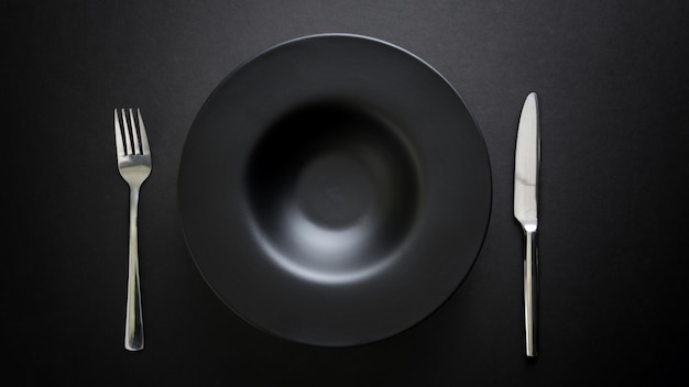 Top view of cutlery and empty plate