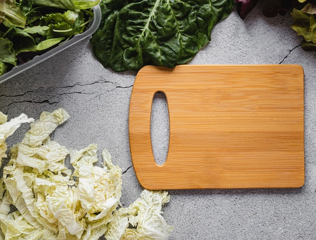 Top view cutting board and salad