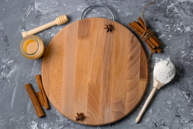 Top view cutting wooden board on a shabby kitchen table