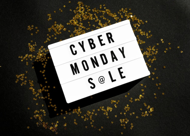 Top view of cyber monday light box with gold glitter